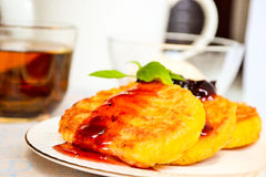 Curds pancakes with cherry marmalade Stock Images