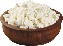Curds in wooden bowl. Royalty Free Stock Image