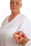 The Cure. A medical patient holding a handful of pills.  The focus is on the pills Royalty Free Stock Photo