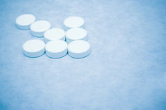 This is the cure. Closeup of an arrow made of tablets - blue tint stock image