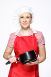 Cure female chef posing with saucepan Royalty Free Stock Photos