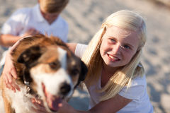 Cure Girl Playing with Her Dog Royalty Free Stock Images