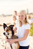 Cure Girl Playing with Her Dog Outside Stock Image