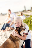 Cure Girl Playing with Her Dog Outside Royalty Free Stock Photos