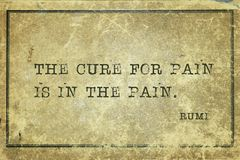 Cure for pain Rumi. The cure for pain is in the pain - ancient Persian poet and philosopher Rumi quote printed on grunge vintage cardboard royalty free stock image