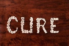Cure sign on wooden background Stock Image