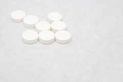 This is the cure - white. Closeup of an arrow made of tablets stock images