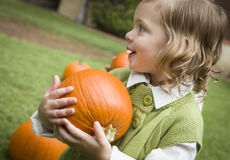 Cure Young Child Girl Enjoying the Pumpkin Patch. Stock Photography