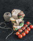 Cured chicken and spinack whole grain sandwich tower with spices Royalty Free Stock Photography