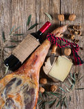 Cured ham leg, spanish tapas, glass and bottle of red Stock Photos