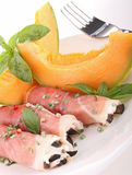 Cured ham and melon Stock Photography