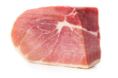 Cured Ham. A piece of prosciutto isolated on white background. Cured Ham Royalty Free Stock Images