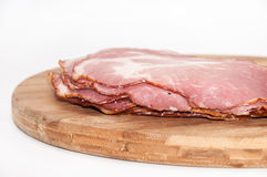 Cured ham on the wooden board Stock Images