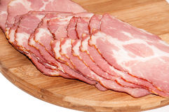 Cured ham on the wooden board Stock Image
