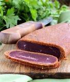 Cured meat - basturma in hot pepper (paprika) Stock Image
