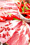 Cured meat with chilli pepper Stock Photography