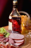 Cured meat, sausage, cognac Stock Photography