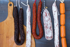 Cured meat and sausages Stock Images