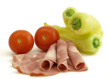 Cured meat with vegetables. Isolated on white background Stock Photography