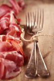 Cured Meat and vintage forks Stock Photos