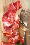 Cured Meat and vintage forks Stock Photography
