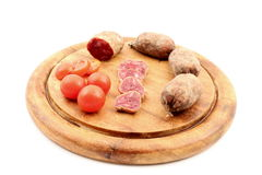 Cured meats with tomatoes Royalty Free Stock Photo