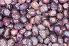 Cured Mediterranean black olives background Royalty Free Stock Photography