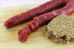 Cured Paprika sausage with wholewheat bread Stock Photo