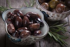Cured greek olives. Cured, pickled or brined olive t on wooden table Stock Image