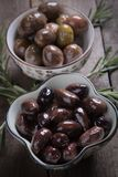 Cured greek olives. Cured, pickled or brined olive t on wooden table Stock Photo