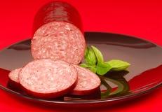 Cured salami with basil Stock Photos