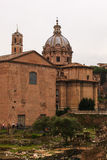 Curia Iulia and the dome of the Santi Luca e Martina, Rome Stock Image
