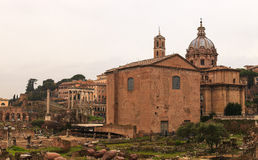 Curia Iulia and the dome of the Santi Luca e Martina, Rome Stock Images