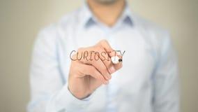 Curiosità, scrittura dell'uomo sullo schermo trasparente Fotografia Stock Libera da Diritti
