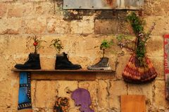 Curiosities in Acre, Akko, boots and shoes, handbags, as flower pots, exterior design and decoration, in Israel royalty free stock images