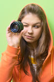 Curiosity. Beautiful women with photo lens Stock Photo