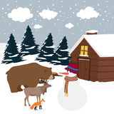 Curiosity of animals. Interested in snowman Stock Photo