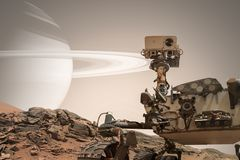 Curiosity Mars Rover exploring the surface of red planet. Elements of this image furnished by NASA stock image