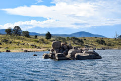 'Curiosity Rocks' and Lake Jindabyne in Australia. 'Curiosity Rocks' and Lake Jindabyne on a cool autumn afternoon in Australia Stock Photo