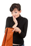 Curiosity young woman with present bag Royalty Free Stock Image