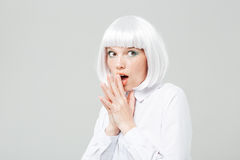Curious amazed young woman with opened mouth. Over white background Royalty Free Stock Photography