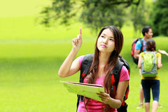 Curious asian girl camping in the park Royalty Free Stock Photos