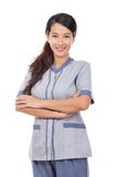 Curious Asian maid in uniform thinking Royalty Free Stock Photo