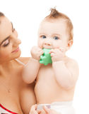 Curious baby biting toy. Bright picture of curious baby biting toy royalty free stock photo