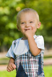 Curious baby boy in the park Royalty Free Stock Image