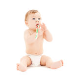 Curious Baby Brushing Teeth Stock Images