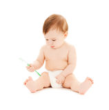 Curious baby brushing teeth Stock Image