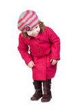 Curious baby girl with pink coat Stock Photos