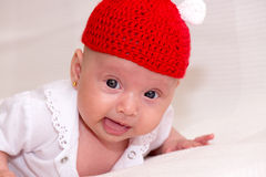 Curious baby girl. With red hat Royalty Free Stock Photos