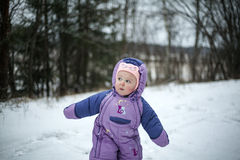Curious Baby Girl Walking in Cold Winter Day Royalty Free Stock Photography